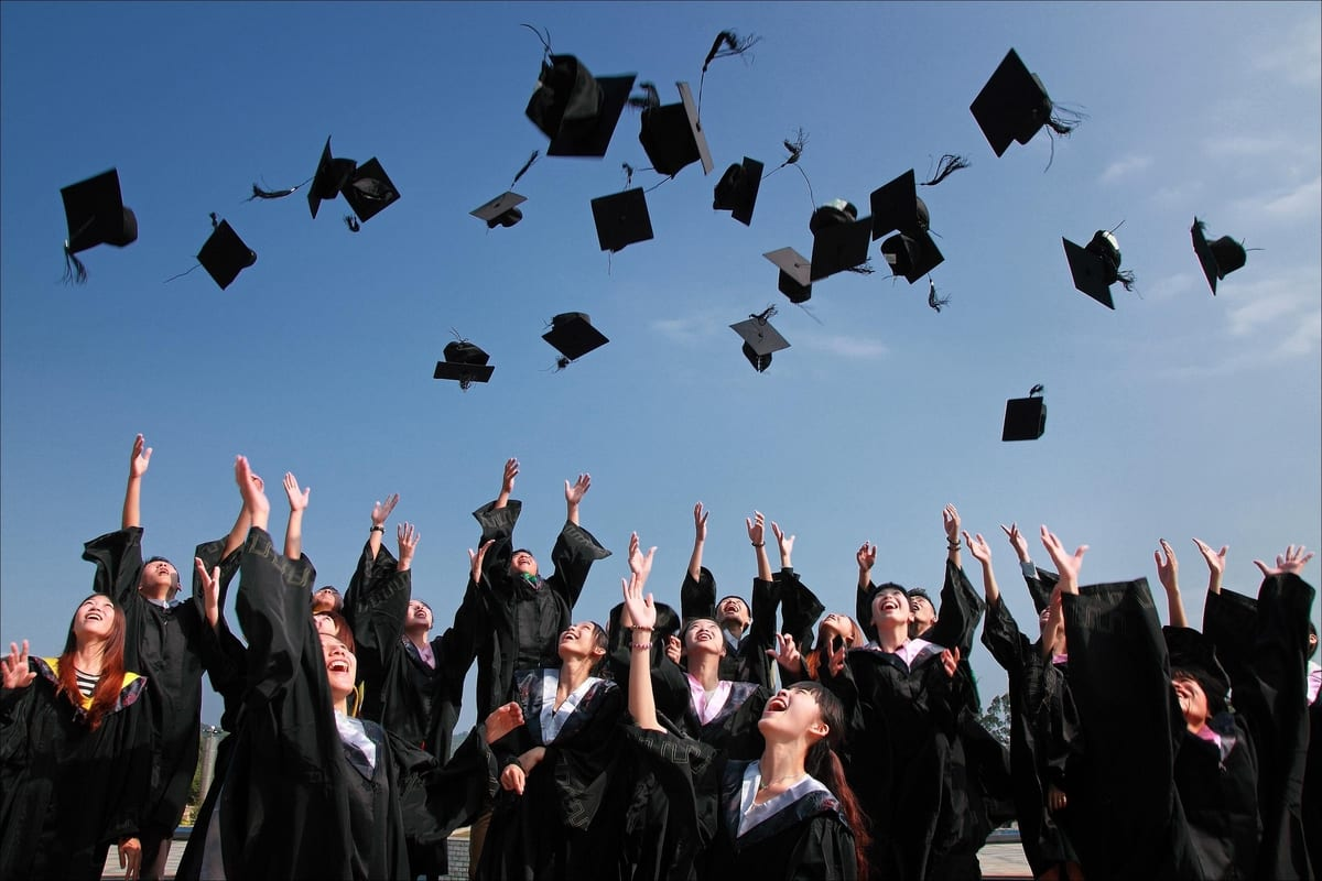 university students pass exam graduation