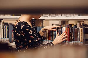 DIversification-PhD-girl-in-library-pixabay-300px-compressed